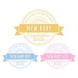 Crachás azuis e cor-de-rosa para recém-nascido Imagem de Stock