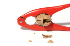 Crack. Nutcracker with cracked walnut Royalty Free Stock Photo