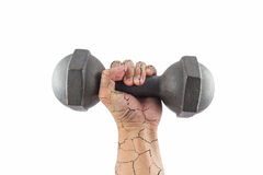 Crack arm with dumbbell. Left broken arm and hand holding a retro dumbbell isolated on white background royalty free stock images