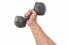 Crack arm with dumbbell. Right broken arm and hand holding a retro dumbbell isolated on white background stock photo