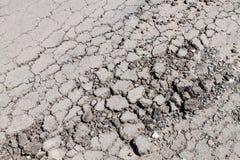 Crack  asphalt road texture Stock Photography