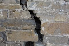 A crack on a big castle wall.  stock photography