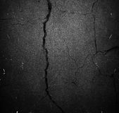 Crack black background or texture Stock Photo
