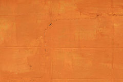 Crack brick wall paint by orange Royalty Free Stock Photo