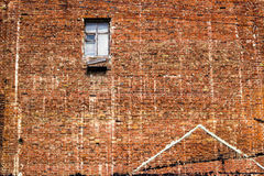 Crack brick wall texture background on day noon light with broken window. For interior or exterior brick wall building decoration texture background Stock Images