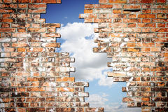 Through a crack of a brick wall you see the sky Royalty Free Stock Image