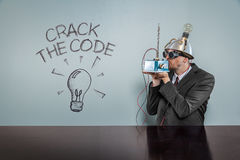 Crack the code text with vintage businessman Royalty Free Stock Image