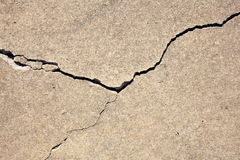 Crack in concrete. Close-up of a damaged concrete block with a crack across Royalty Free Stock Image