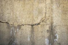 Crack concrete wall background. Grunge floor texture. Aged cement stone. Grey surface closeup royalty free stock images