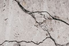 Crack concrete wall. Old dirty cracked wall texture. Gray stone background. Abstract pattern of grunge floor. Messy damage worn of stock photography