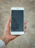 Crack Display Smartphone Screen Holding on Hand Royalty Free Stock Photo