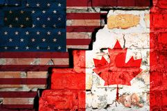 The crack between the flags of America and Canada closeup stock image