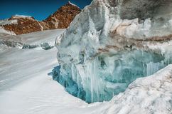 Crack in the glacier in the mountains with blue ice Royalty Free Stock Photo