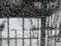 Crack in the glass. Abstract background with crack. Cracks in the glass. Black abstract background with cracks stock photography