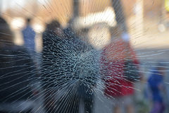 Crack in glass close up. Royalty Free Stock Image