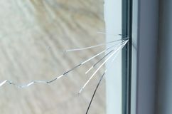 Crack on the glass at a residential house stock image