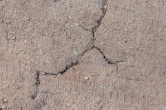 Crack on gravel road. With tire print, for background use Stock Images