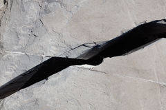 Crack in a gray stone texture background royalty free stock photography
