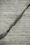 Crack on grey cement surface. Long diagonal Crack on grey cement surface stock photo