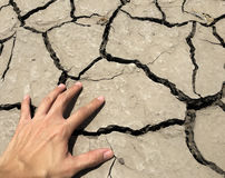 Crack ground and stress hand Royalty Free Stock Image