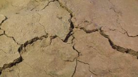 Crack growing in shaking ground land destruction Earthquake disaster concept life threat close up background. Crack growing in the ground land destruction stock video