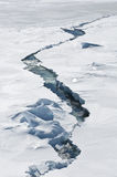Crack in the ice. A crack in the ice leaving space for some sea water, Antarctica Royalty Free Stock Photo