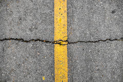 Crack on line yellow on road texture Stock Image