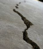 Crack in pavement 4. Close-up view of a crack in concrete stock photo