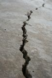 Crack in pavement. Close-up view of a crack in concrete stock photo
