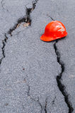 Crack road and safety hat Stock Photos