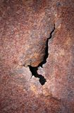 Crack at rusty metal plate. Brown oxidized texture Stock Images