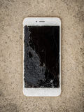 Crack Screen Smart Phone on Floor Royalty Free Stock Images
