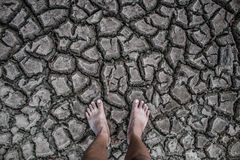 Crack soil drought area on stand foot. Stock Photo