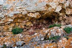 Crack Stone background. Cracks in the mountain with orange regions stock image