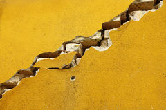 Crack on the wal. A huge crack on the wall close up Royalty Free Stock Images
