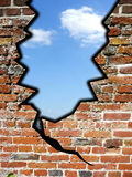 Crack In The Wall. Conceptual image about breaking down a wall for freedom Stock Image