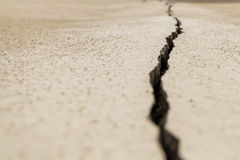 The crack on the wall. The crack on the beige stucco wall Royalty Free Stock Photo
