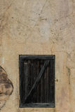 Crack wall. Old wooden door on crack wall Royalty Free Stock Photos