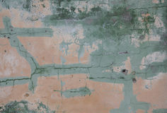 Crack wall texture and paint.Abstract background. Painted pink and green cracked wall Stock Images