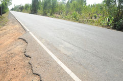 Cracked asphalt countryside road Royalty Free Stock Photos
