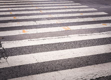 Cracked asphalt crosswalk, pedestrian crossing Stock Images