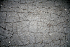 Cracked asphalt pavement Royalty Free Stock Images