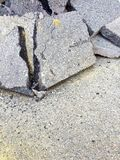 Cracked asphalt pieces background - concept image royalty free stock photo