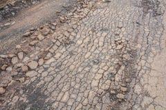 Cracked asphalt road Royalty Free Stock Photo