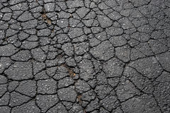 Cracked asphalt road surface texture Royalty Free Stock Photo