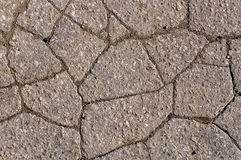 Cracked asphalt road surface texture. Grey texture of the road Stock Images
