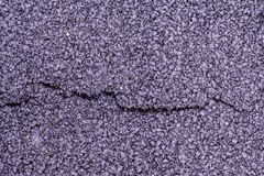 Cracked asphalt on road texture Stock Image