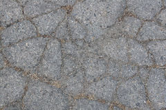 Cracked Asphalt With Sand and Dirt Royalty Free Stock Photos