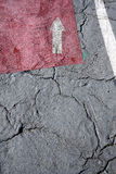 Cracked asphalt with 'way out' arrow Stock Image