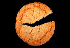 Cracked biscuit on black Royalty Free Stock Images